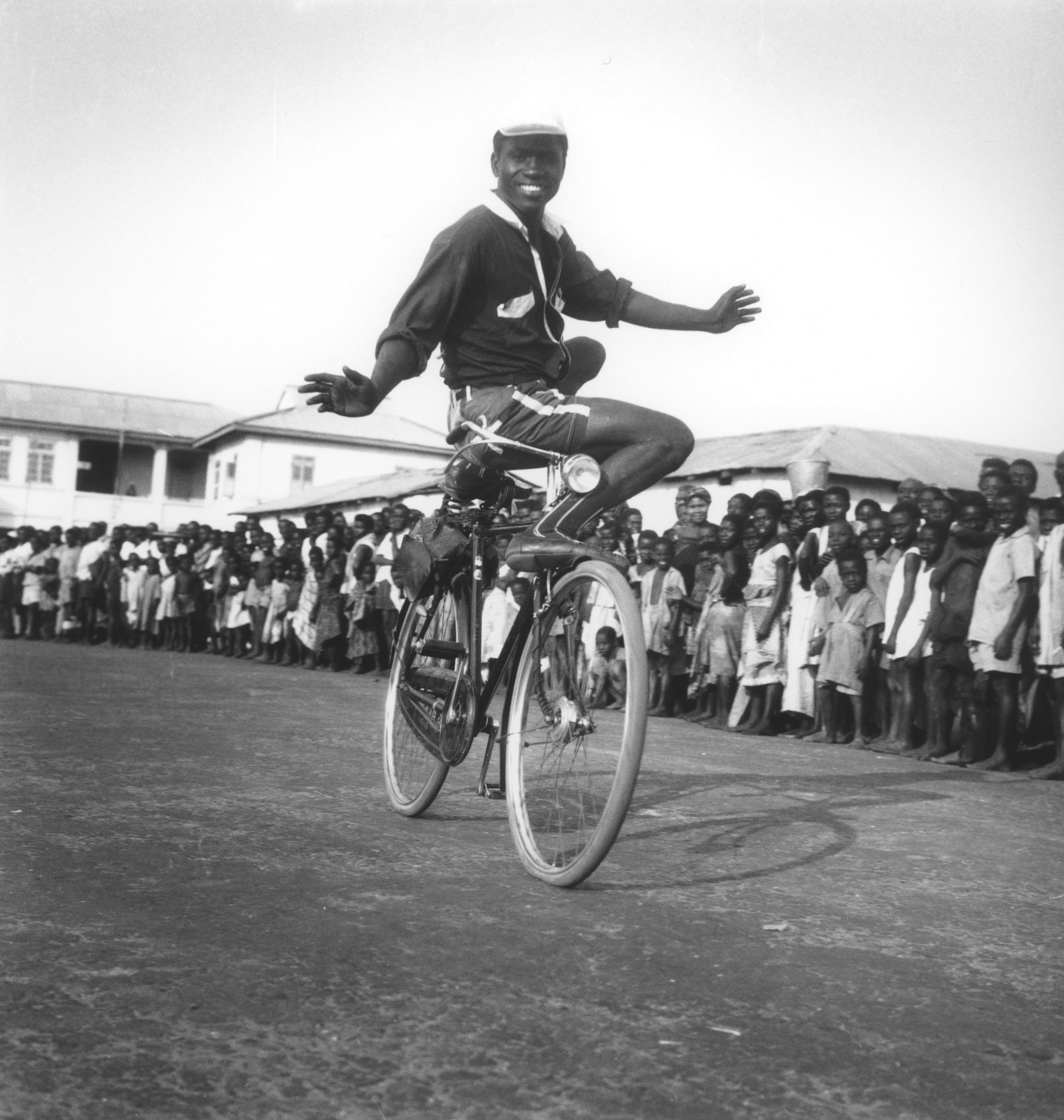 "The ""Nigerian Superman"" in mid acrobatic act, Accra, 1958."