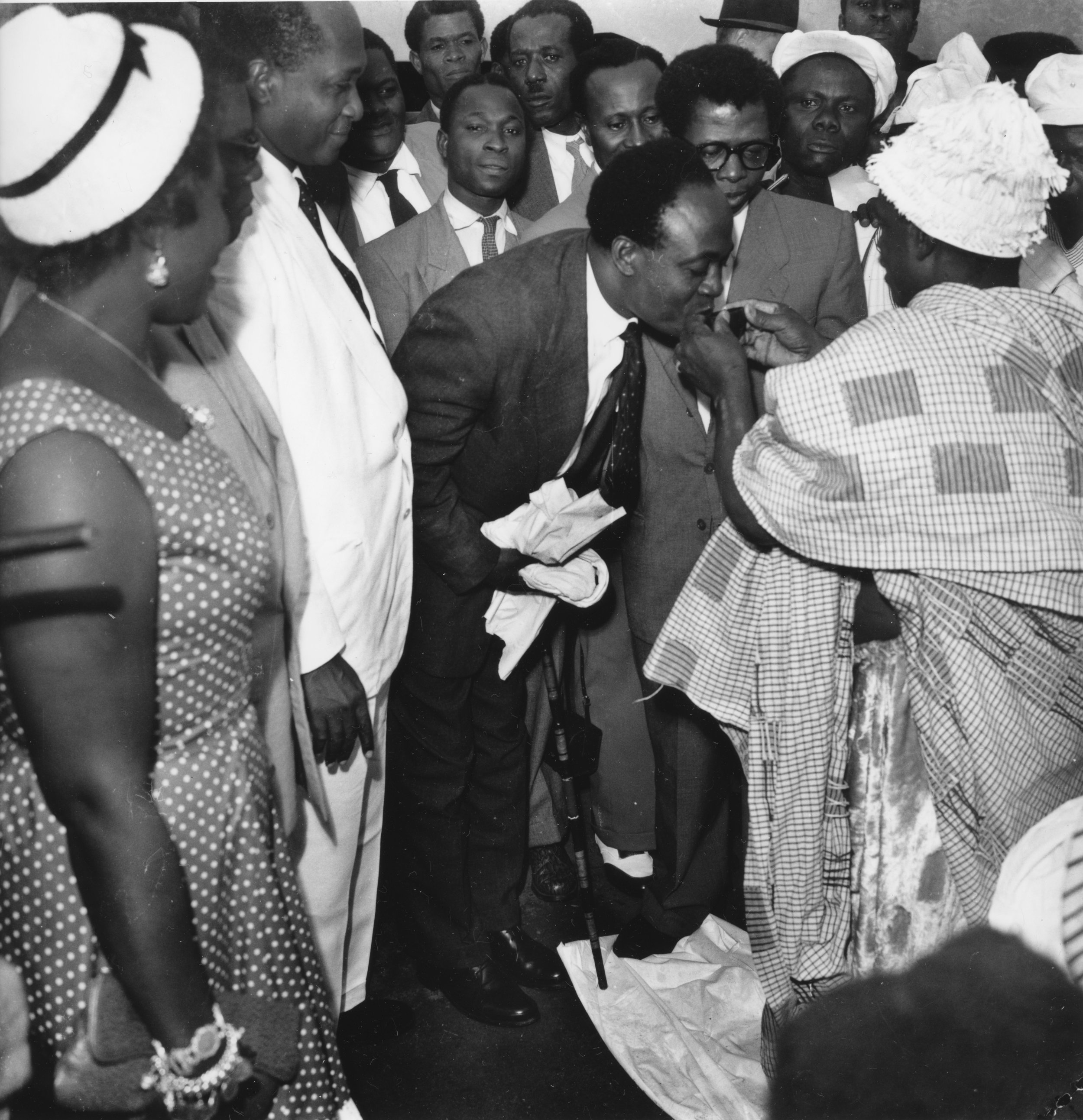 Kwame N'Krumah welcomed home after his trip to London where he took part in the Commonwealth Prime Ministers' Conference, Accra, July 1957.