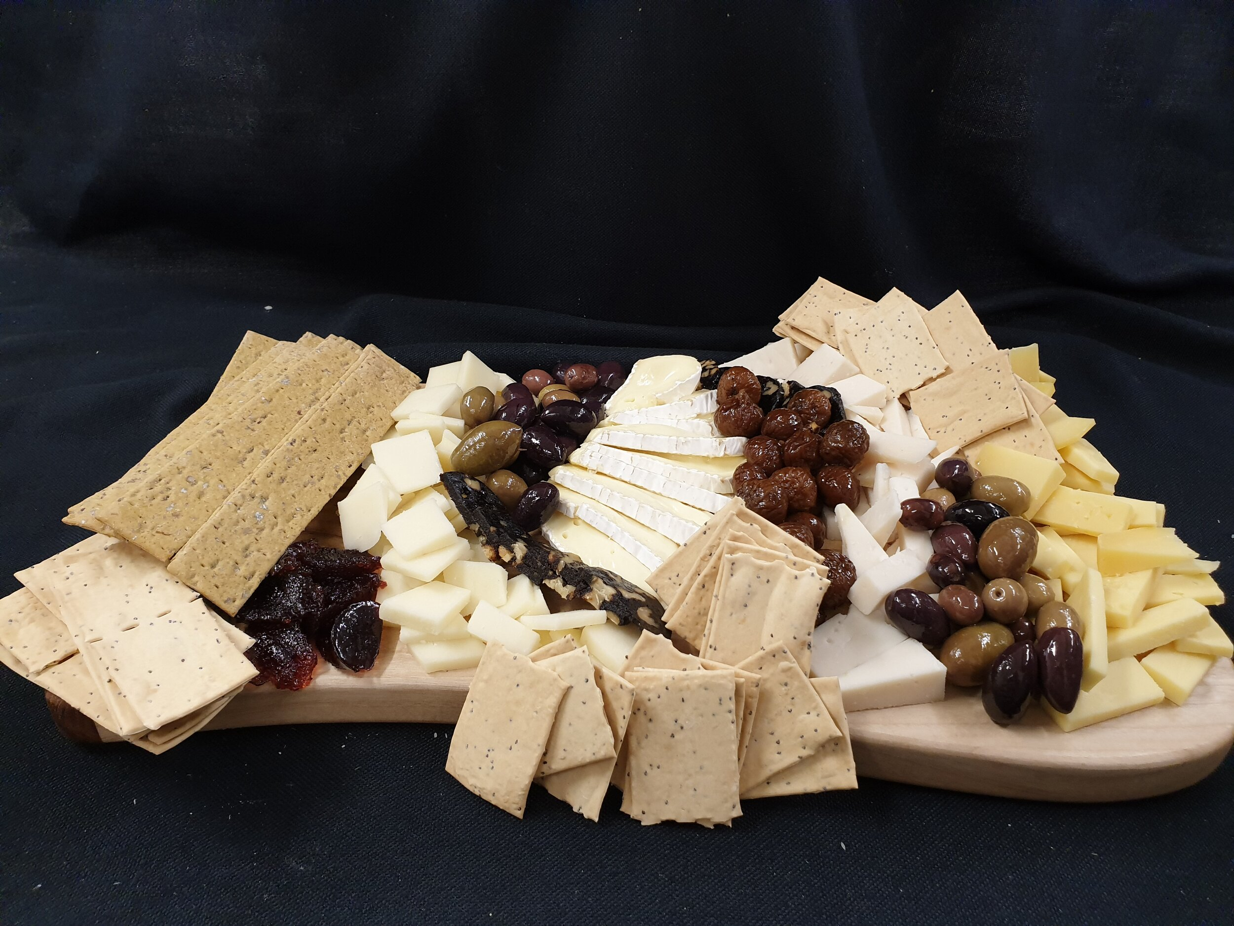 Our latest Creation - The Artisan:Filled with a selection of hand made crackers, Australian grown olives and an exquisite line of cheese from across the globe
