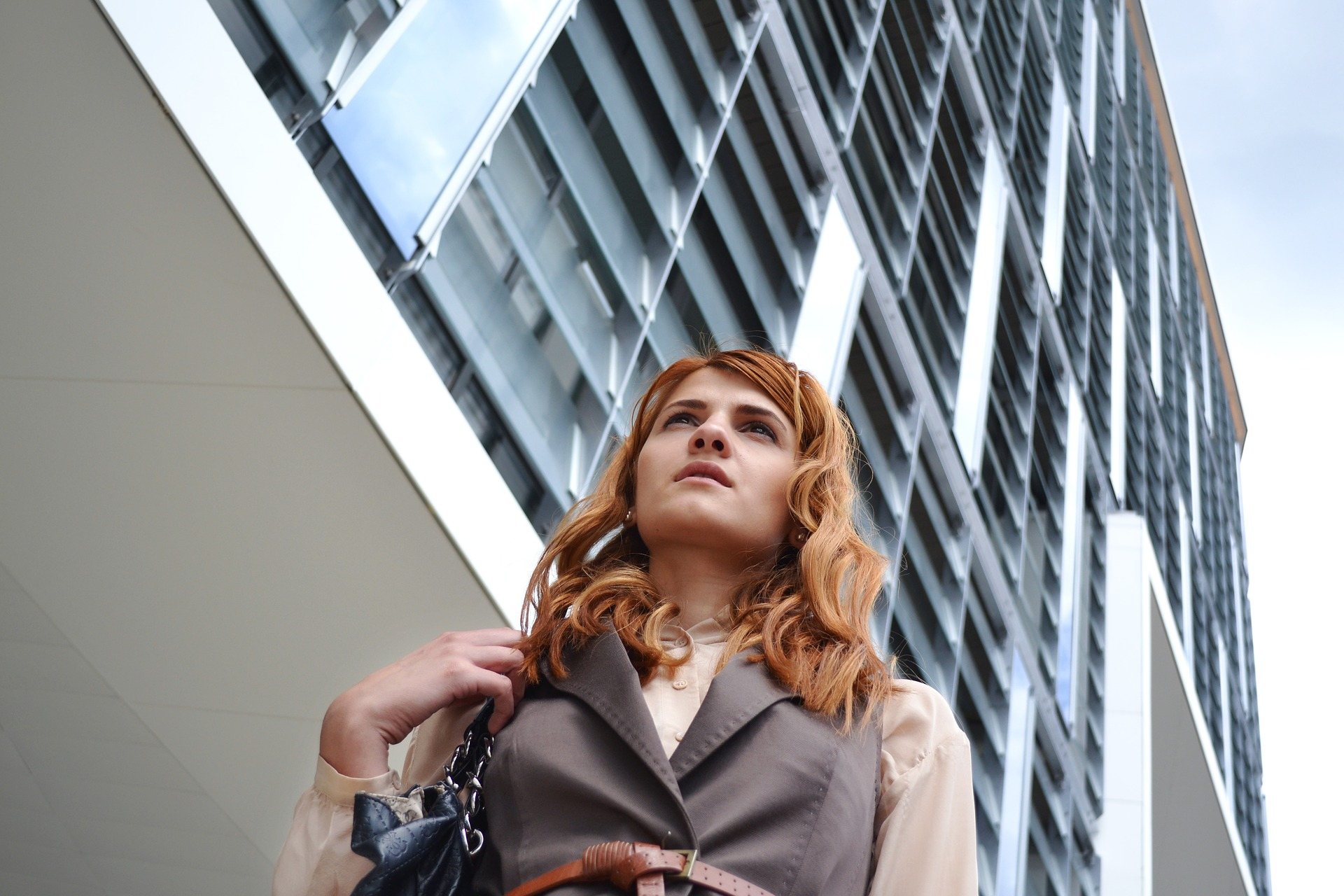 business-woman-looking up building in back.jpg