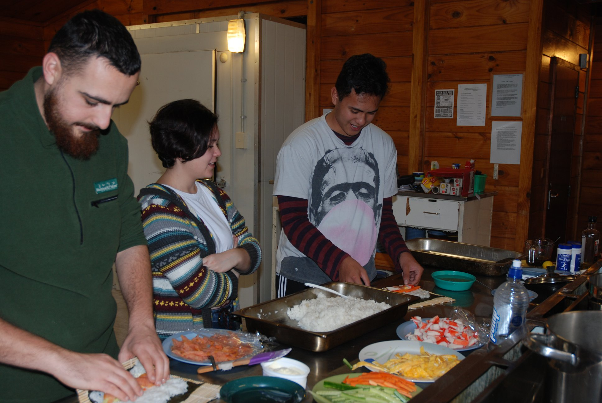 Participants learn to roll sushi during an arts workshop