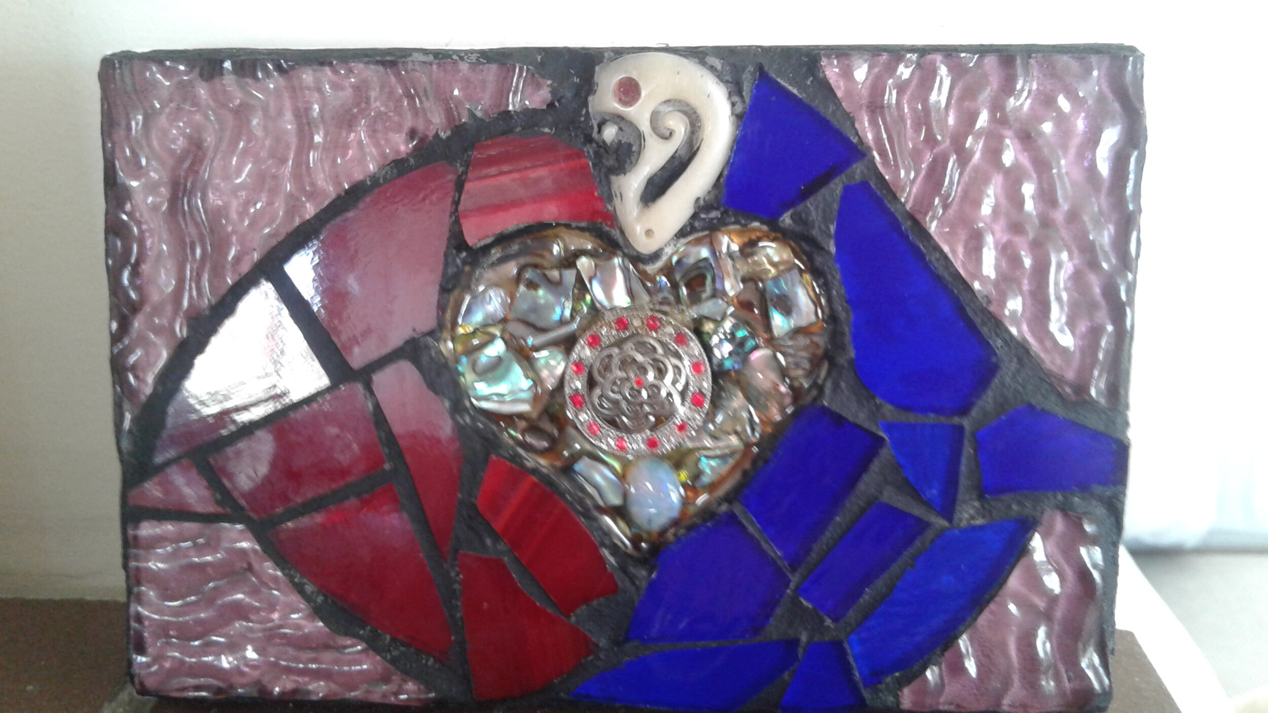 """From Thames-Coromandel, a ceramic piece inspired the Words of Bahá'u'lláh, """"In the garden of thy heart plant naught but the rose of love."""""""