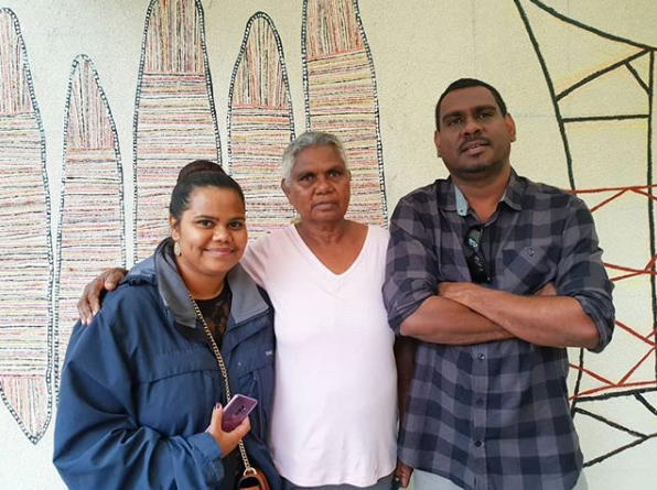 Regina Pilawak Wilson stands proud with her granddaughter and son in a humble moment after she completed the last brush strokes on her work here for The Phillips Collection.
