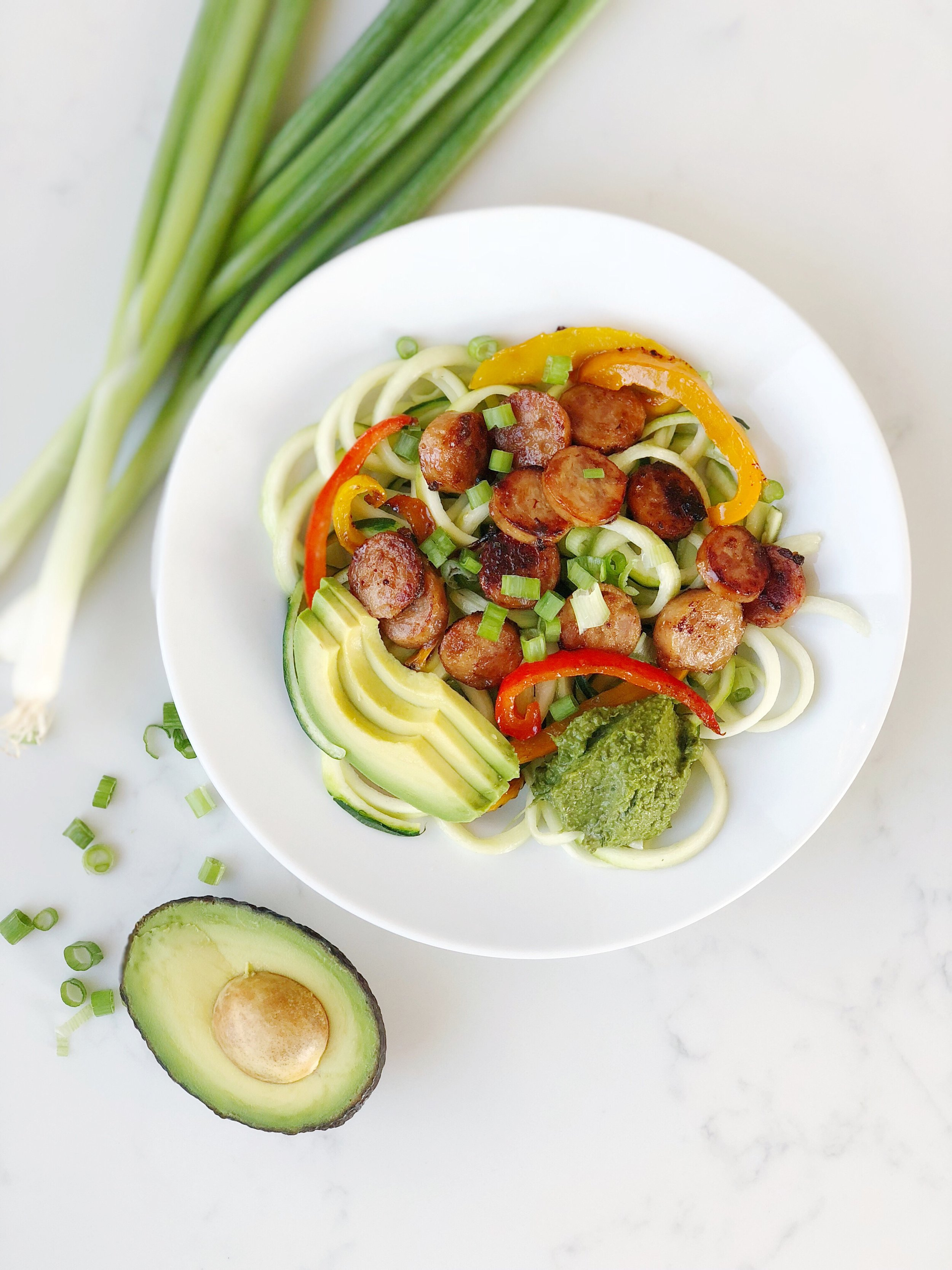 Pesto zucchini noodles with sausage and peppers.JPG