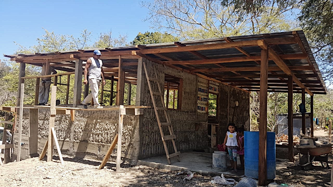 The wooden rods, the chicken wire and the cement are supporting the walls. The house is already very solid.