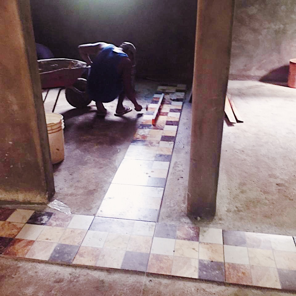 The tiles are being laid.