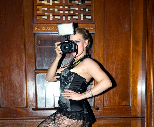 London. Photographer at Burlesque shoot. Fitting in.