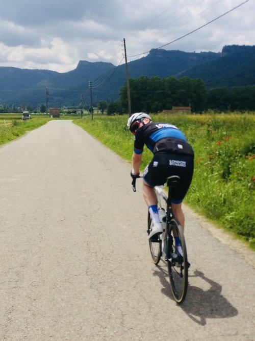 Jed riding towards the Rocacorba mountain in Girona