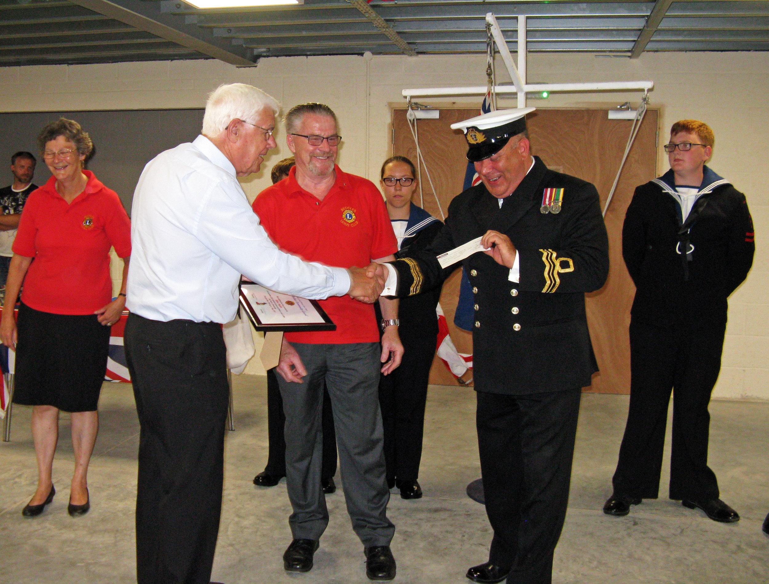 Alf Muffett presenting cheque to TS Brave Commanding Officer Lt.Cdr. Joe Meadows RNR.