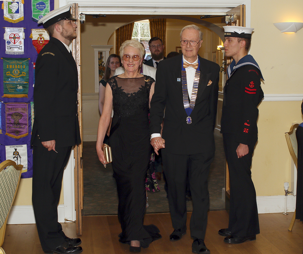 Beccles Lion President Chris Lambert with his wife Carolyn enter the Waveney Suite after being 'piped in' by the Beccles Sea Cadets.
