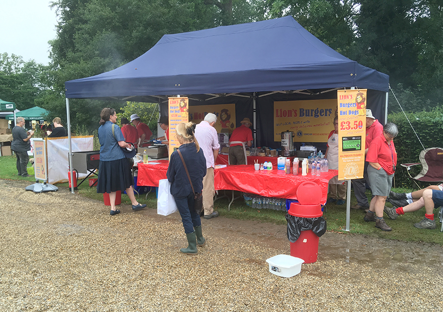 """Our """"fast service' BURGER STALL appears at many functions throughout the year and is available 'free of charge' for suitable organised events within about 30 miles radius of Beccles. Good value and delicious Burgers, Hot Dogs, Bacon Rolls and Tea and Coffee with every penny of profit going to Charity."""