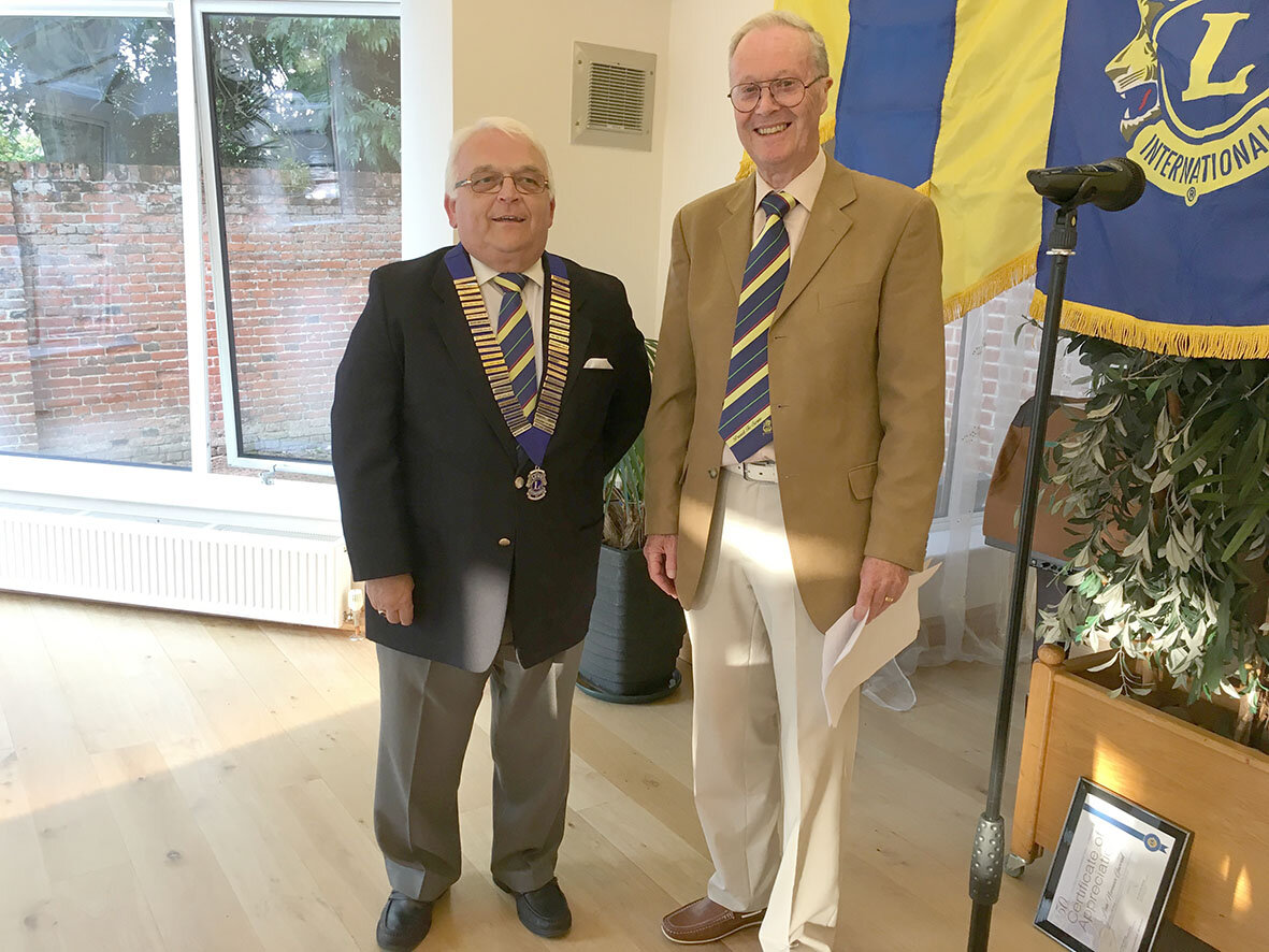 Outgoing President = Lion Chris Lambert (right) after handing over the Club's Chain of Office to President for 2019/20 - Lion Chris Eglington.