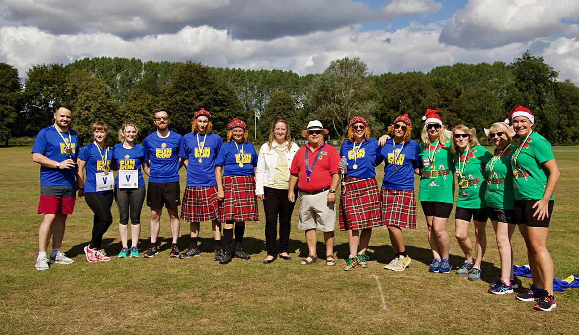 The Relay teams L-R, Blackwell Print, The Wine Vaults (with the Mayor of Beccles and the Lion President in the middle) and Santa's Helpers.