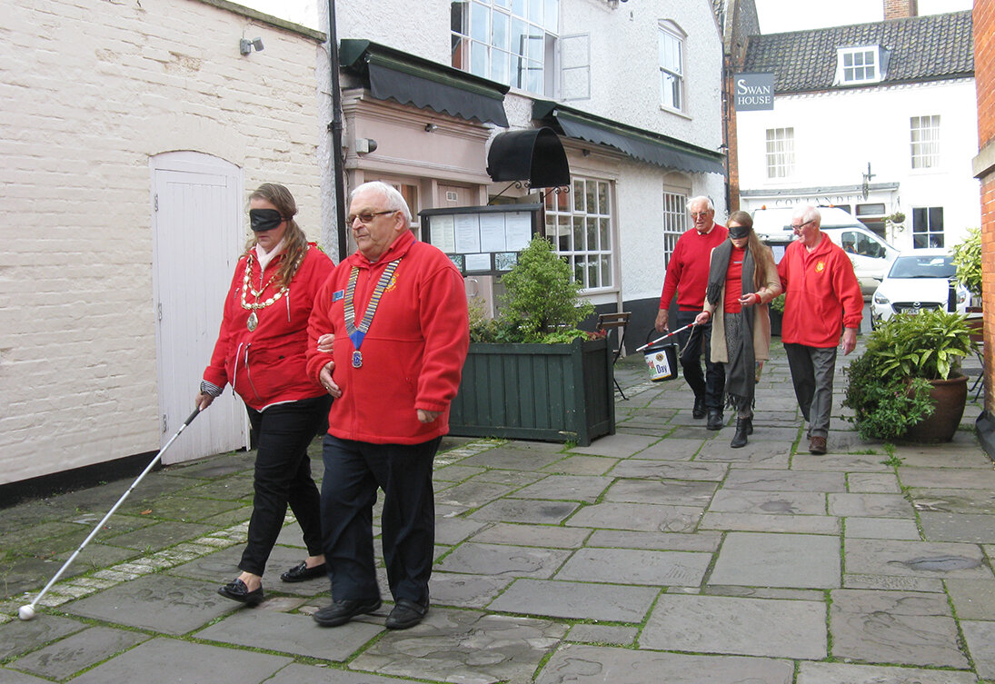 Navigating the flagstone passageway between the Swan PH and the Town Hall.