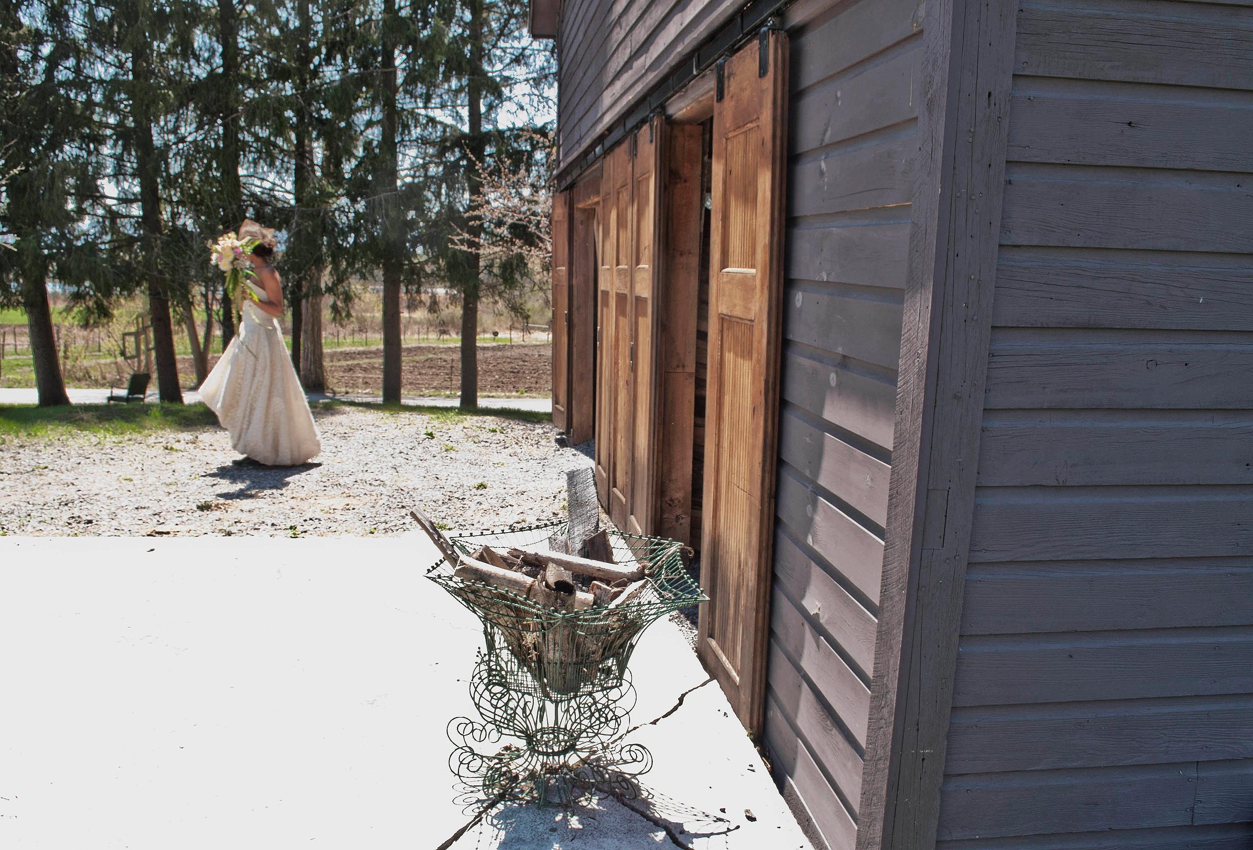 Bride exits the barn at Full Moon Farm, Medusa, NY