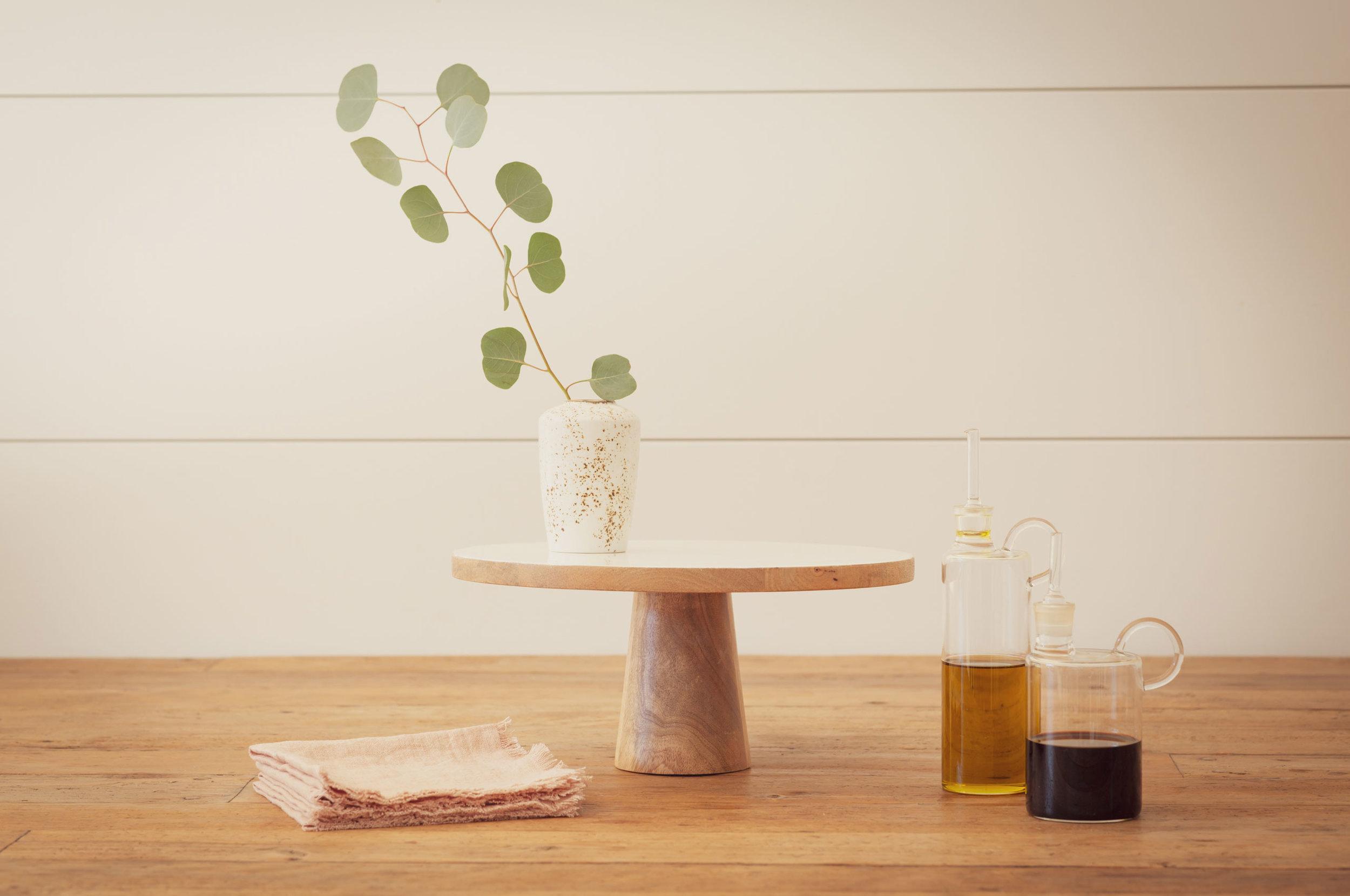 Spring Refresh   ::  Enamel Topped Wood Cake Plate :: Italian Glass Olive Oil Dispenser :: Italian Glass Vinegar Dispenser :: Craft Ceramic Bud Vase :: Blush Linen Cocktail Napkins