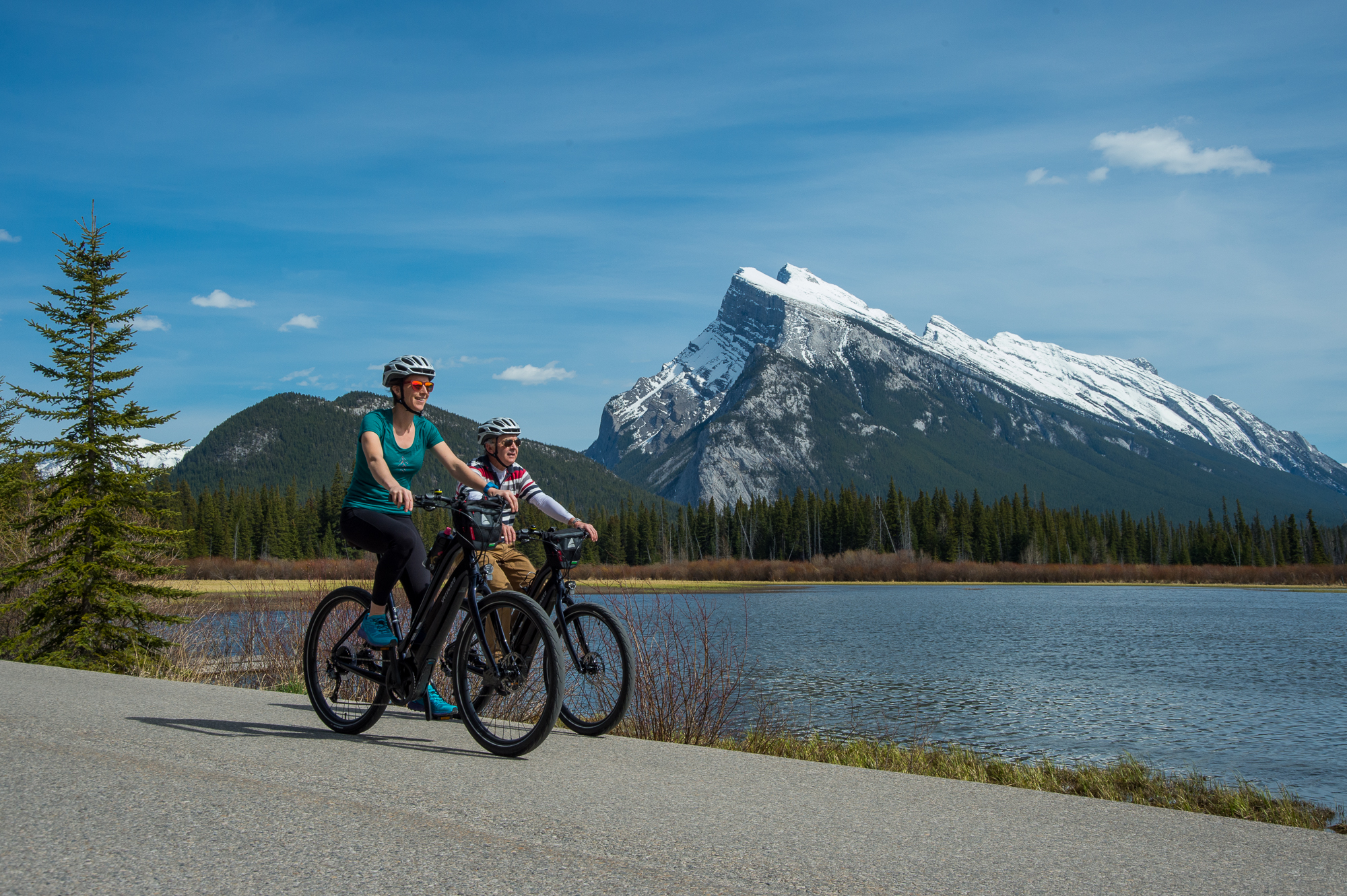 Riding past Vermillion Lakes, with Mount Rundle in the background.