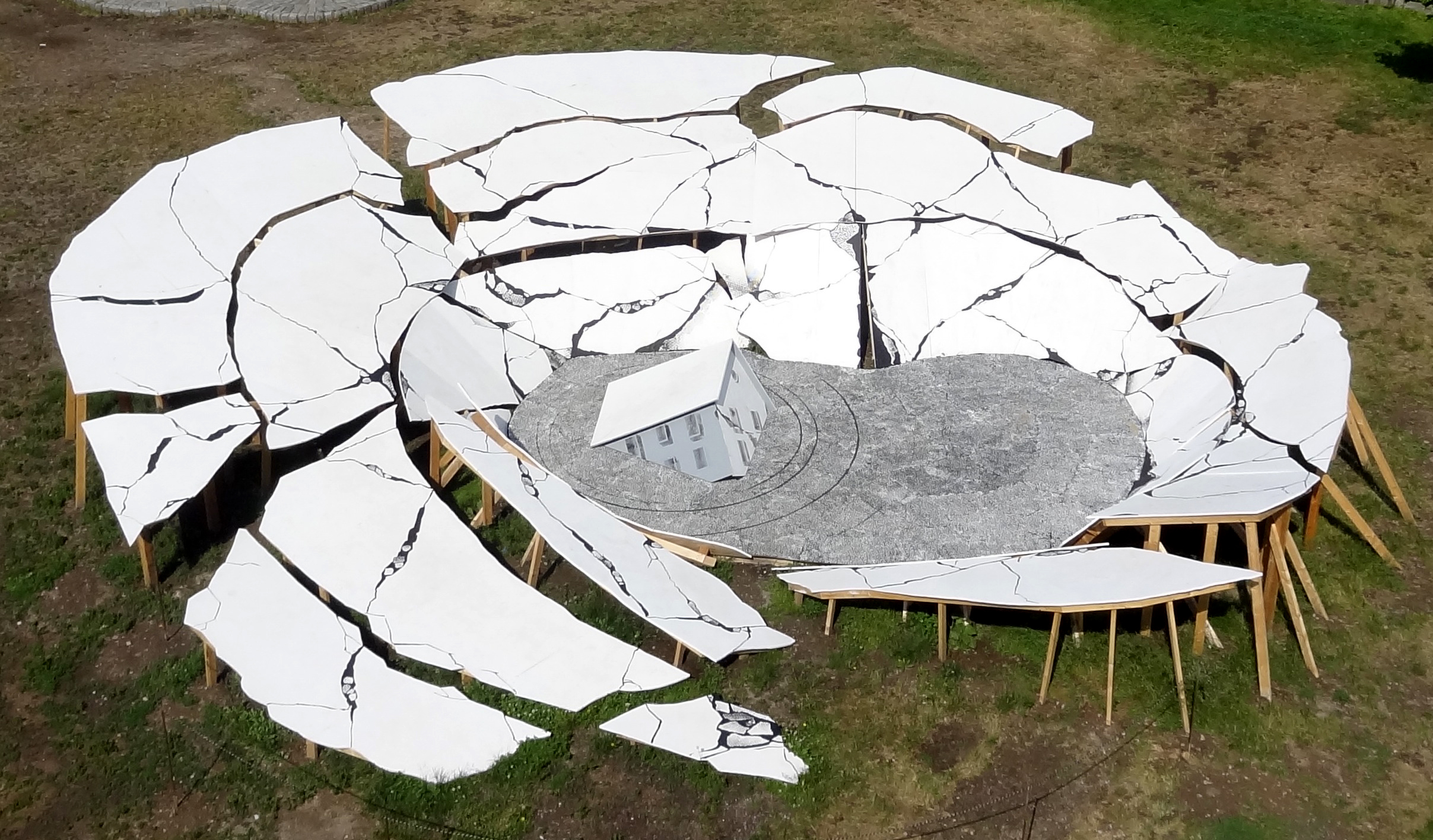 Suspect Terrain , aerial view. 2014-2015, Painted wood, 50 feet across   A large scale public sculpture derived from photo documentation of historical instances of sinkholes.