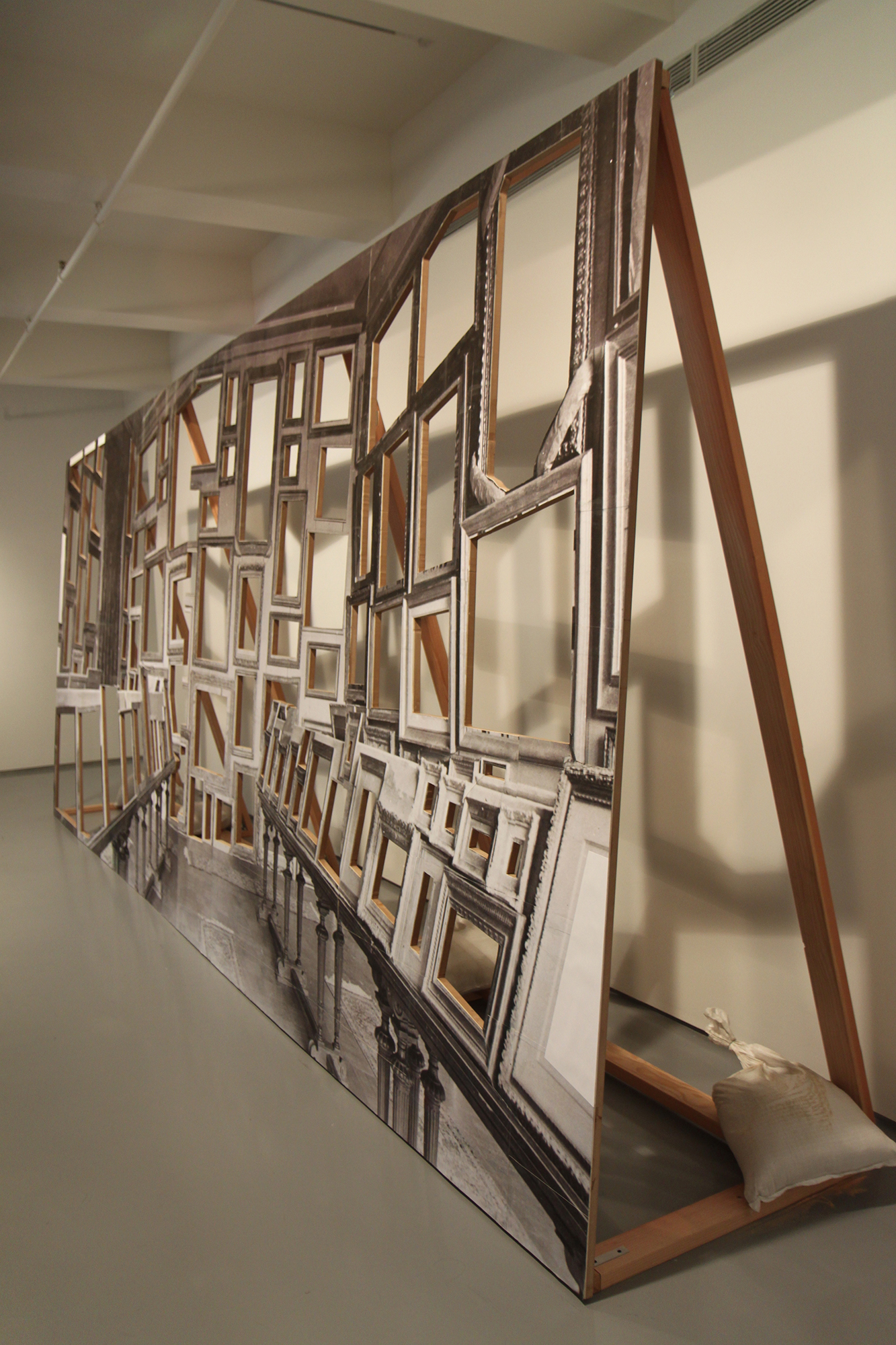 Room of Martyrs (Jeu de Paume) (detail), 2011-2012, photographs on wood with sand bags, 24 feet wide