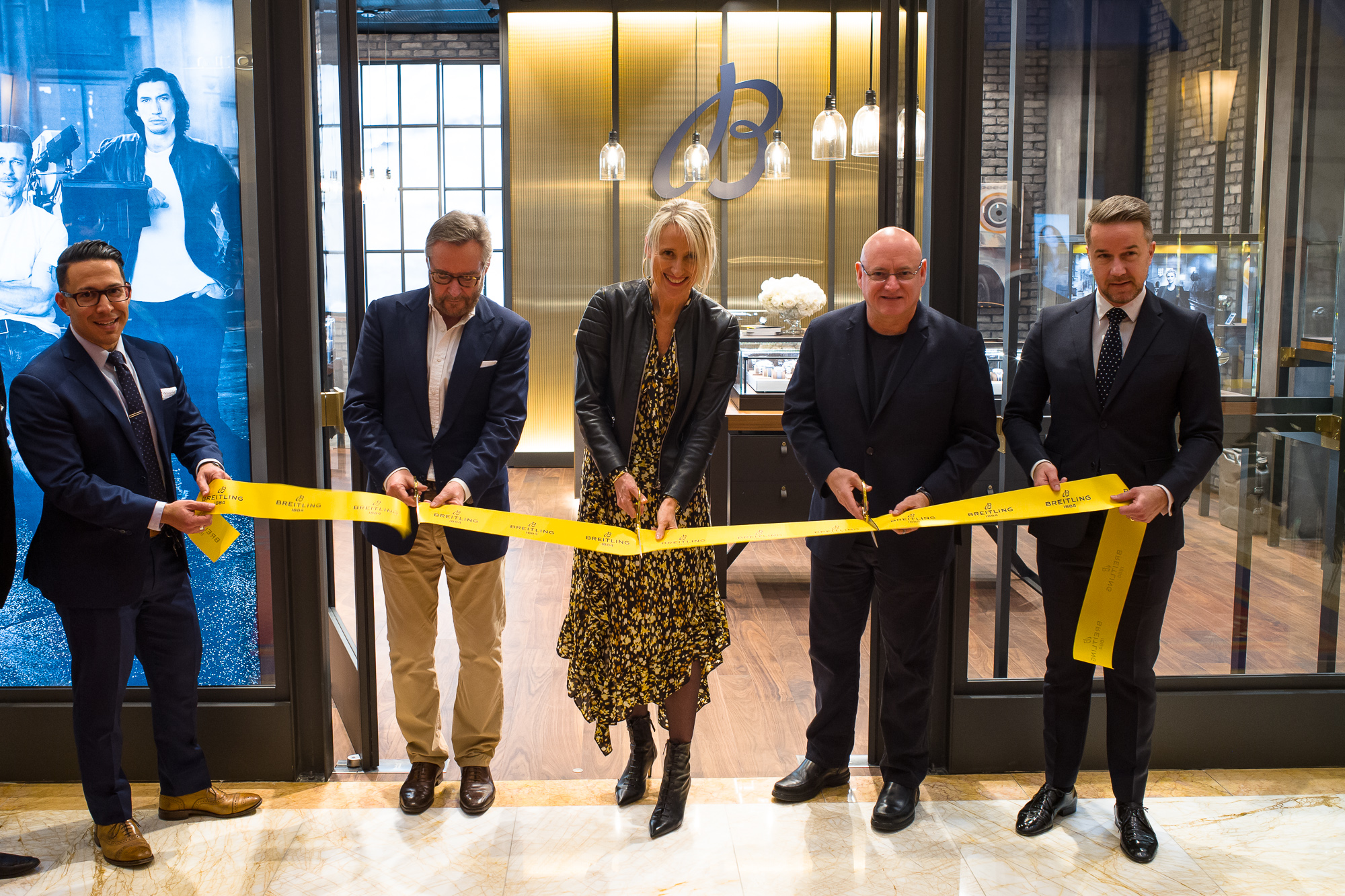 WoS CEO Brian Duffy, Breitling Retail Director Sophie Morice, and Commander Scott Kelly cutting the ribbon at the Esplanade Shops new Breitling Boutique in the Wynn.
