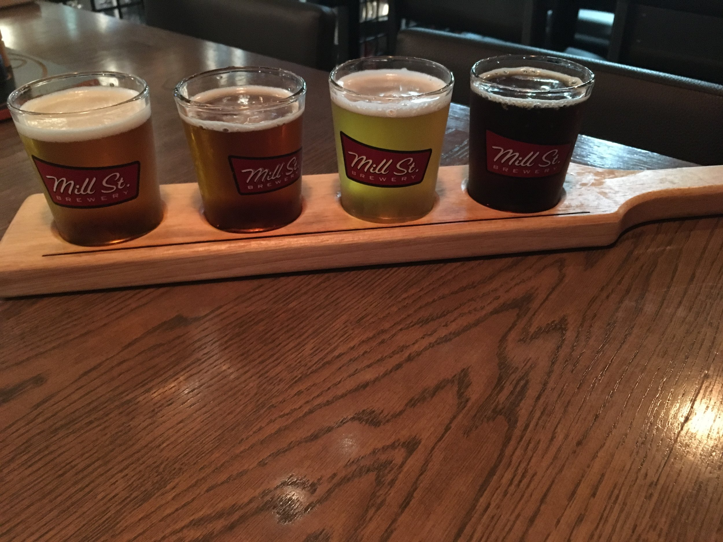Pictured left to right: Lukey's Bock Mai-Bock, Seafaring Saison, Dandy Day IPA Dandelion IPA, and Goodbye Earl! Earl Gray Porter
