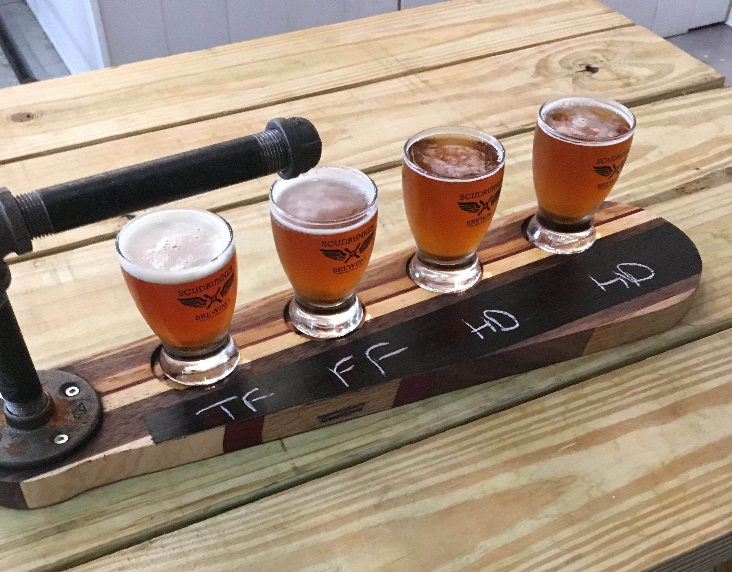 Pictured left to right: Test Flight #1 American Bitter, Frequent Flyer Original Bitter, Hop Duster Session IPA