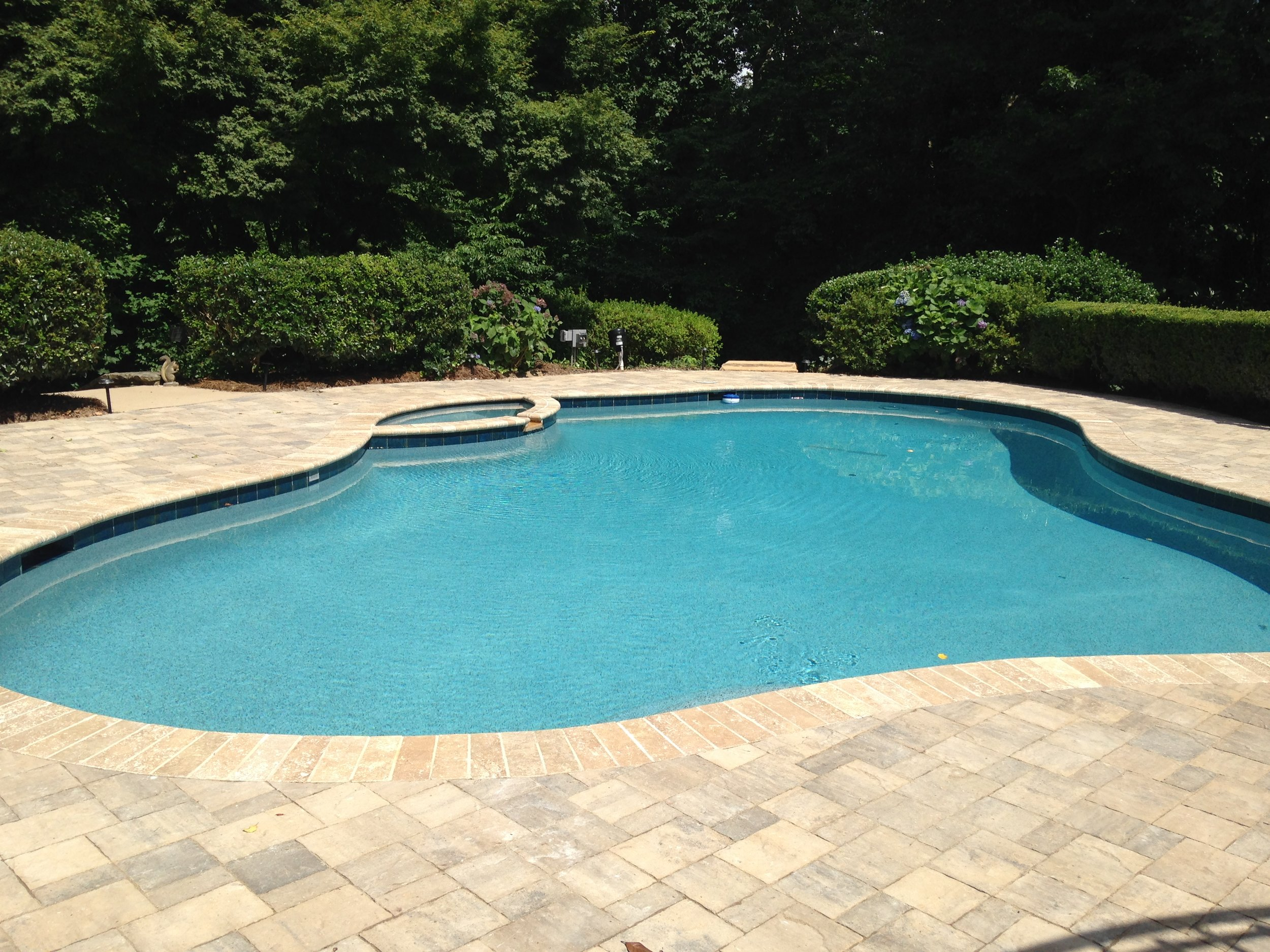 Lafitt pavers and noce travertine.jpg