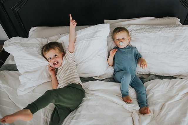 "Jumping on our bed is the most fun. I'm always searching for good quality basics for my boys and these outfits from @wyloandco are some of my favorites! These are from their ""Collective"" set. I love the colors and the soft material. The rompers I got for Jack are my absolute favorite. Use code THANKYOU25 for 25% off when you spend $50."