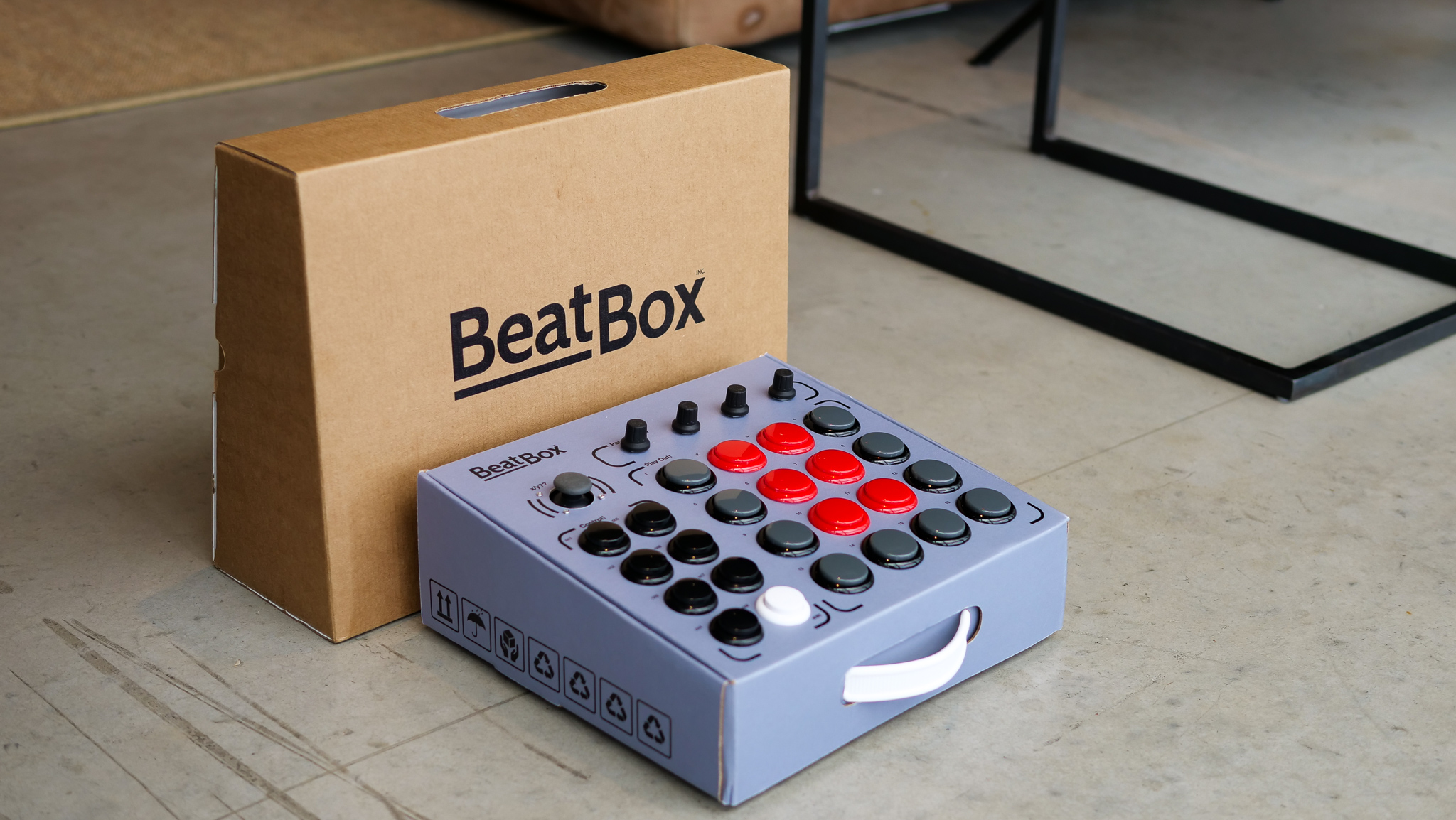 The Beatbox will come with a built-in handle and cardboard carrying case pictured above.