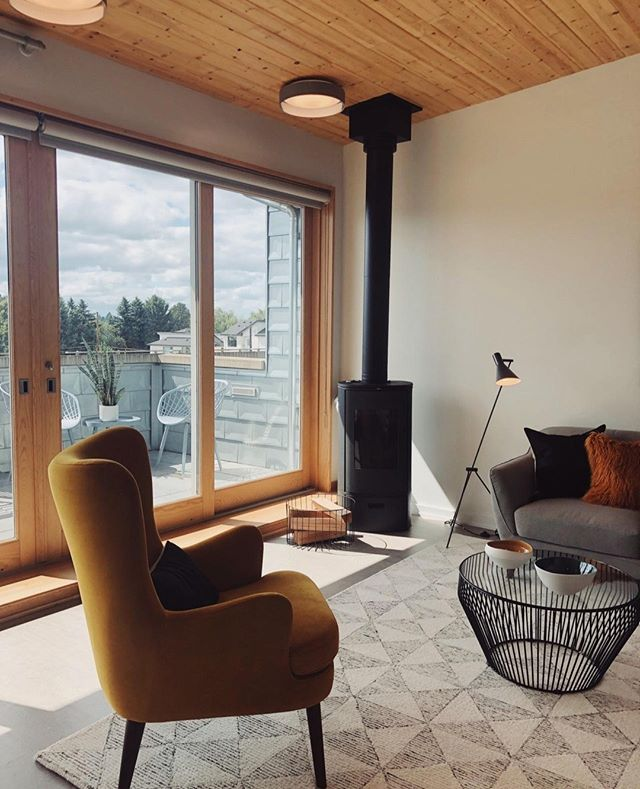 A view and a fireplace.  Mississippi Lofts, Portland, OR.  -- #fireplace #corkfloor #heavytimber #modern #design #build #cedar #pacificnorthwest #architecture #contemporaryarchitecture #architecturephotography #designbuild #custombuilder #minimalism #simplicity #pdx #pdxnow #pdxdesign #portlandarchitecture#pdxrealestate #portlandrealestate #pnwhomes #modernhome #luxuryrealestate #interiordesign  #livingroom #homedesign #cozy #home #homedecor