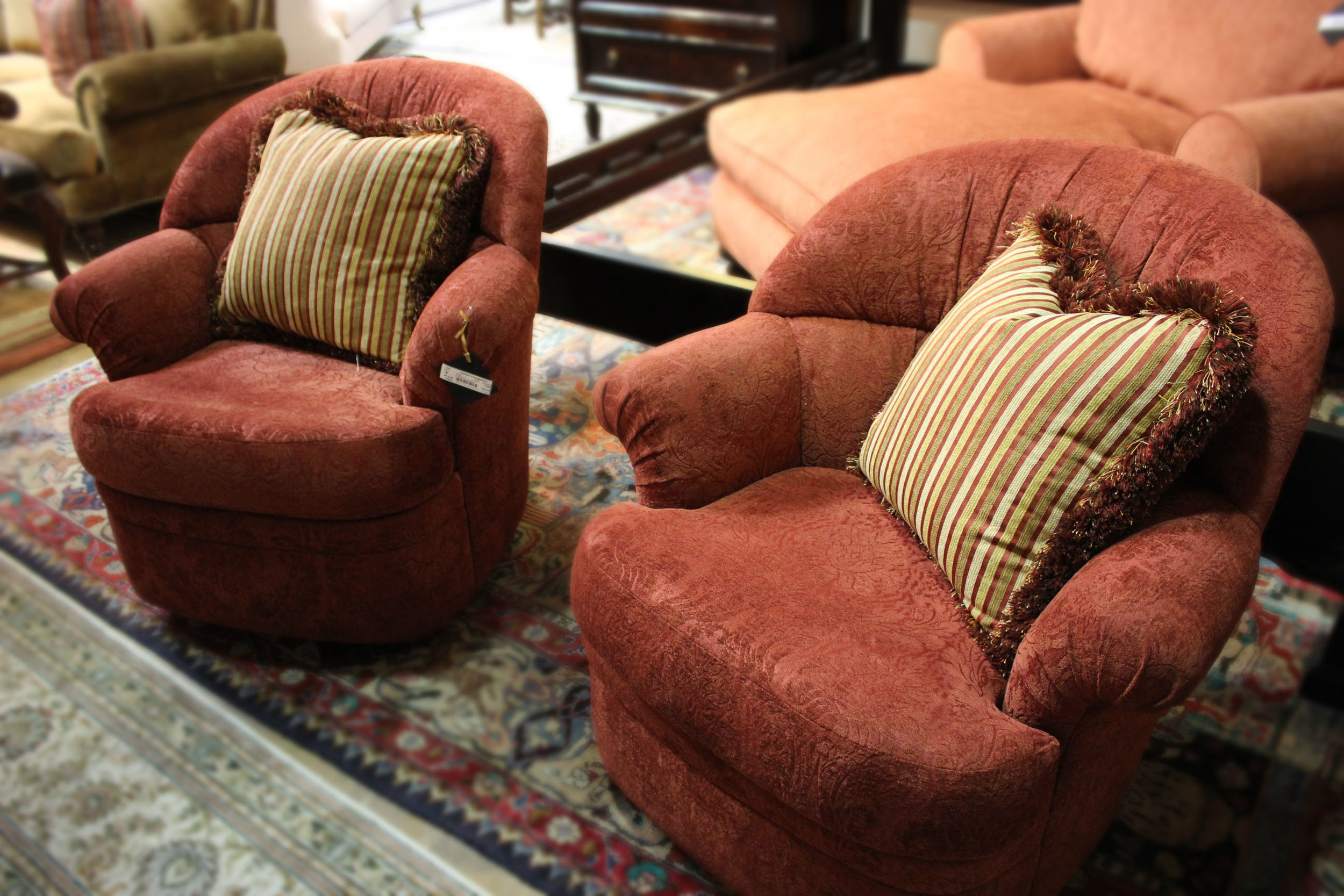 Pair of Red Swivel Chairs