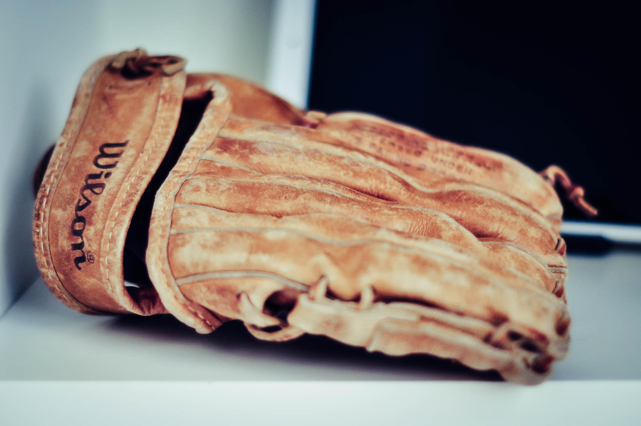Worn leather softball glove