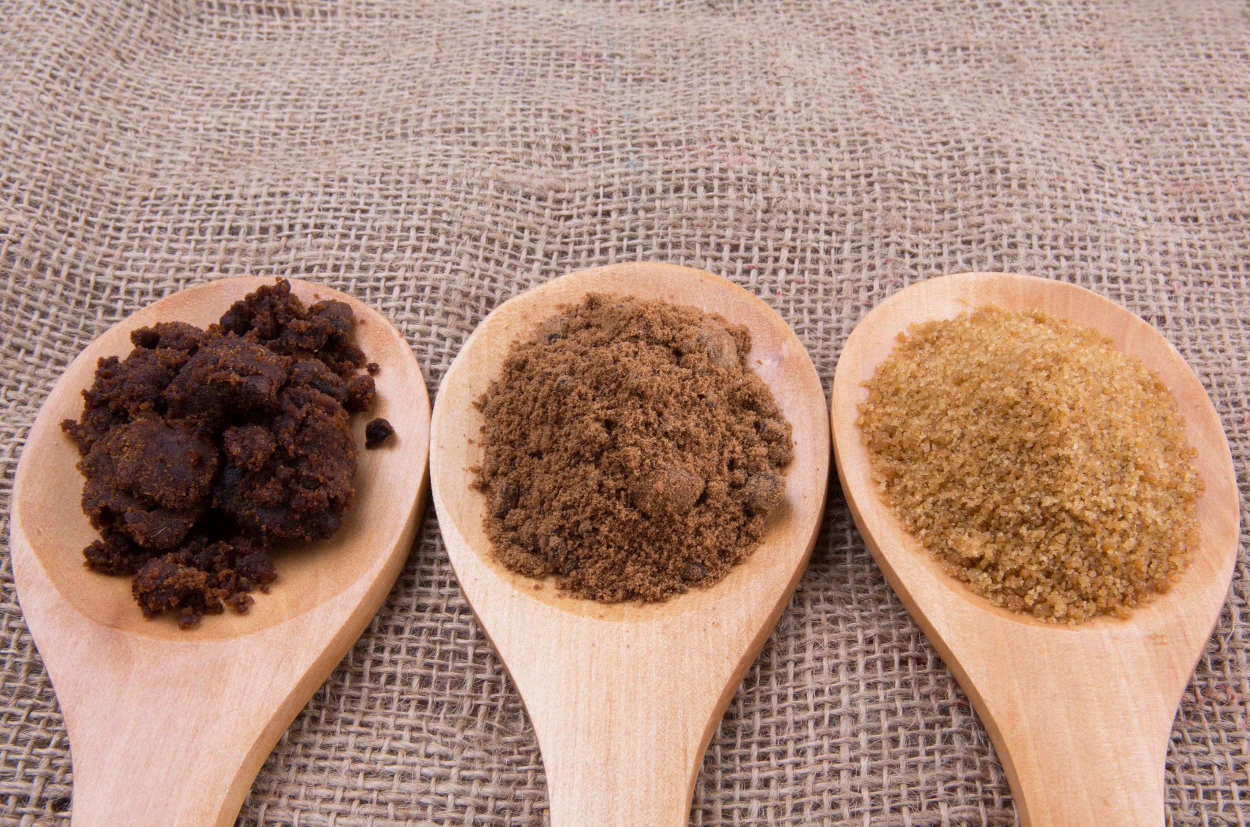 Muscovado sugar, brown sugar and coconut sugar.