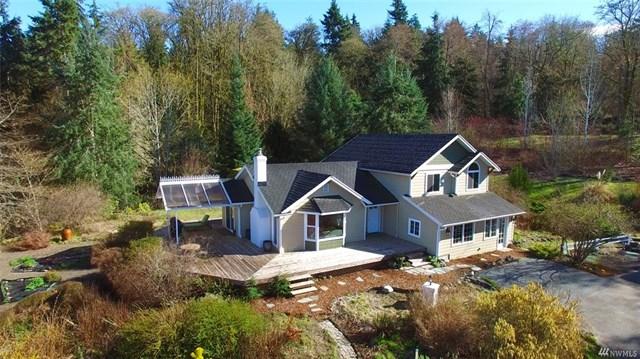 Buying: 10313 SW 268th St, Vashon | List Price: $725,000 | Sold Price: $735,000