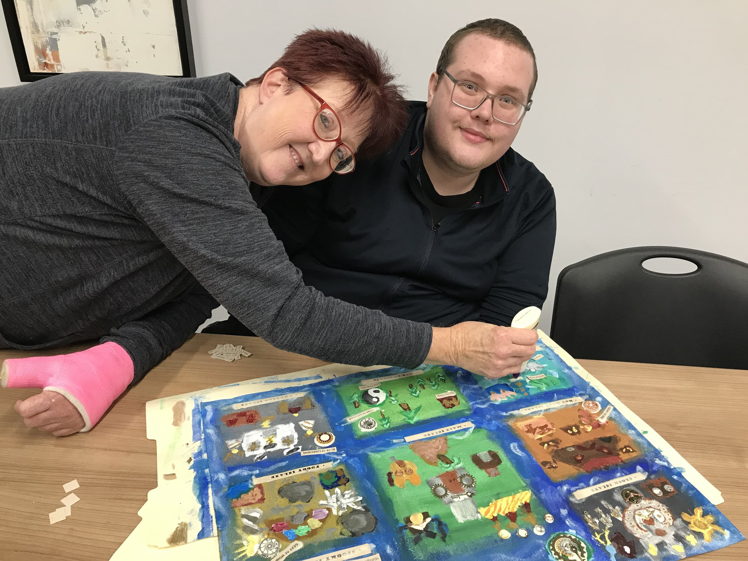 Austin and his mom, my sister, Cherie - The final hours! Austin engages his mom's help to apply the glitter accents, and to attach the metal gears on his mixed media map.