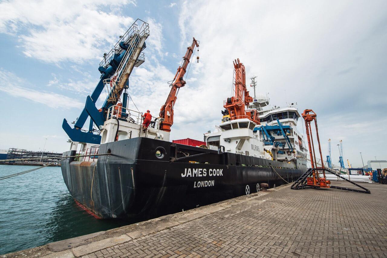 RRS James Cook, during mobilisation, with the BGS' 'Vibrocorer' dockside.