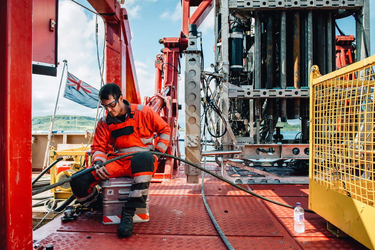 RD2 Sea Trials, Oban, 2015. Gary, a BGS engineer, prepares himself before undertaking an extremely delicate repair of RD2's umbilical cable.