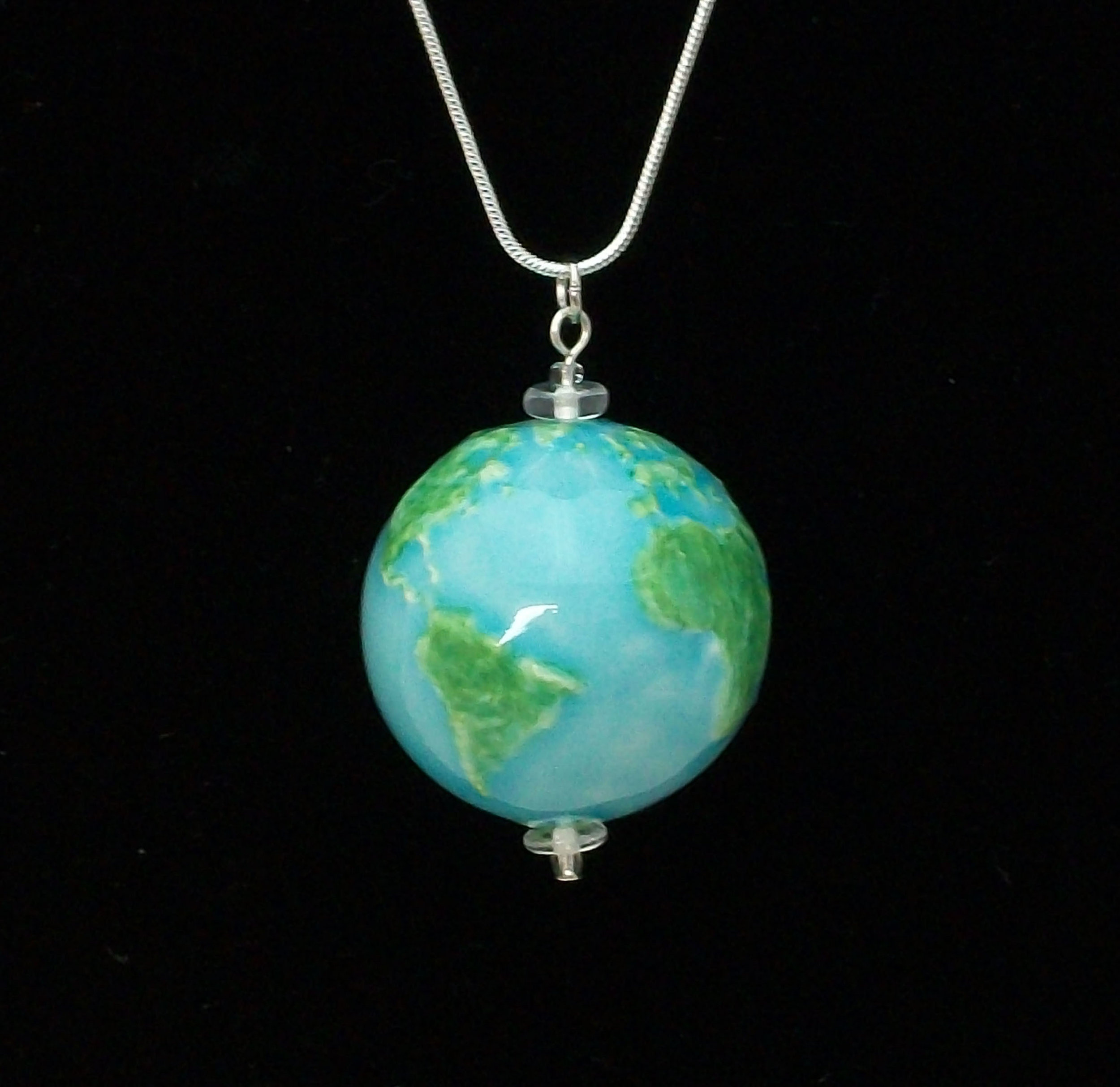 "Globe Pendant on an 18"" or 24"" snake chain."