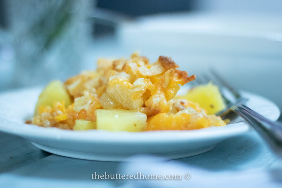 A Southern classic side dish that also doubles as a dessert. Savory Cheddar Cheese enhances the sweetness of chunk Pineapple topped with a salty butter cracker top. Yessirree!