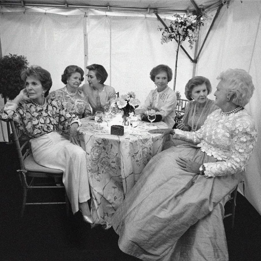 Nancy Reagan, Ladybird Johnson, then-current FLOTUS Hillary Clinton, Roslyn Carter, Betty Ford, Barbara Bush at the U.S. Botanic Garden in Washington, D.C., for the opening of the First Ladies' garden.  May 11, 1994  Photo by Barbara Kinney/The William J. Clinton Presidential Library.