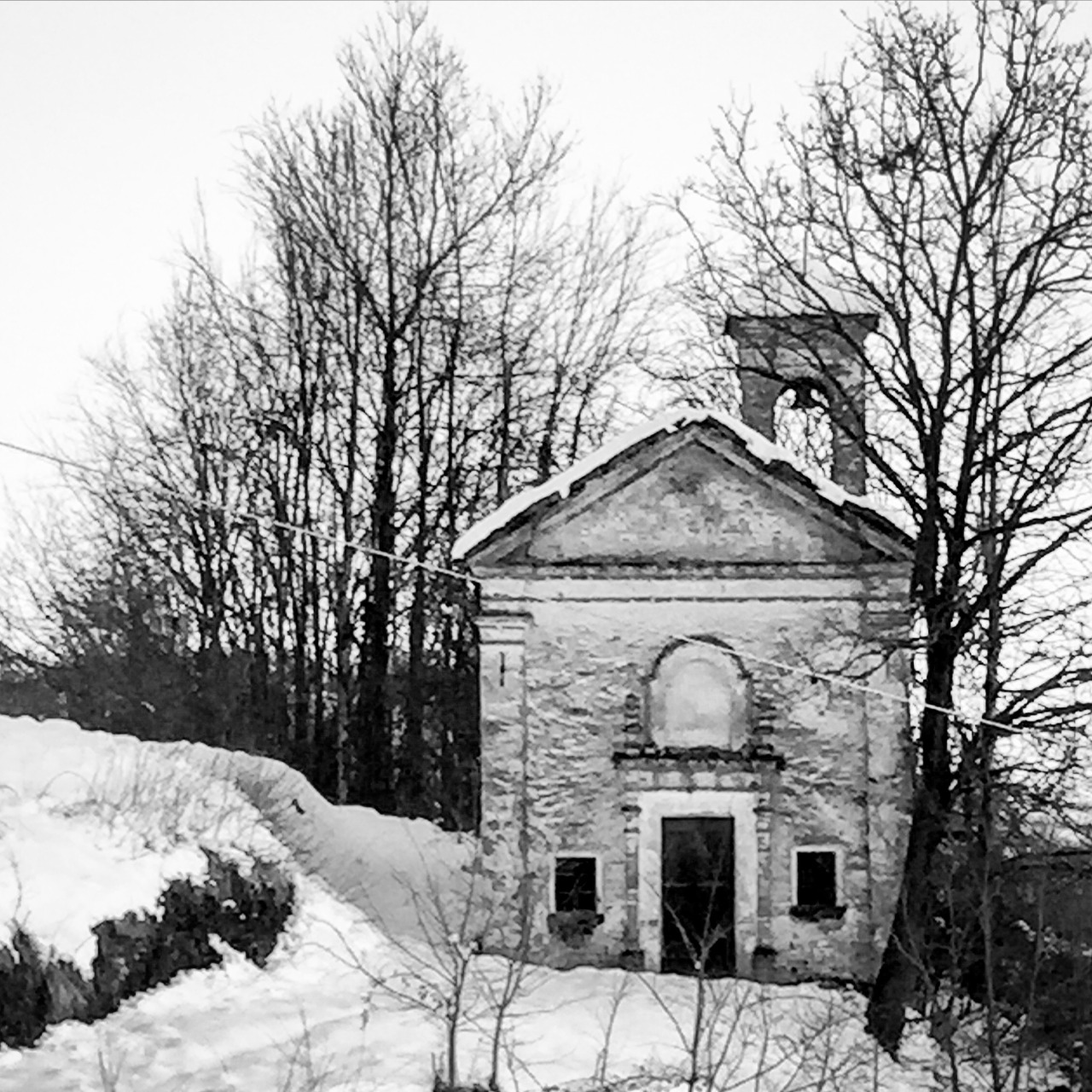 Abandoned, snow-draped church in the hills of Piedmont, Italy.