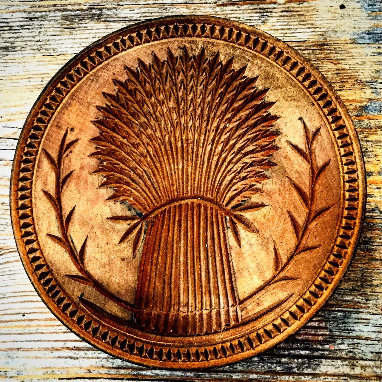 Butter stamp.  Carved oak.  American, late 1800s.
