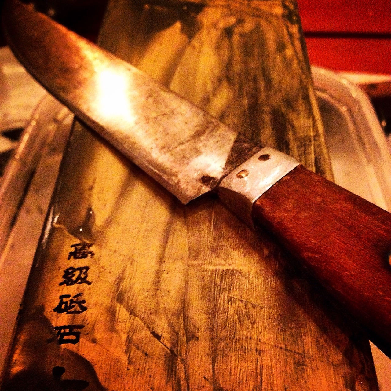 Long overdue sharpening of our eclectic collection of kitchen knives, cleavers and shears on a Japanese whetstone.