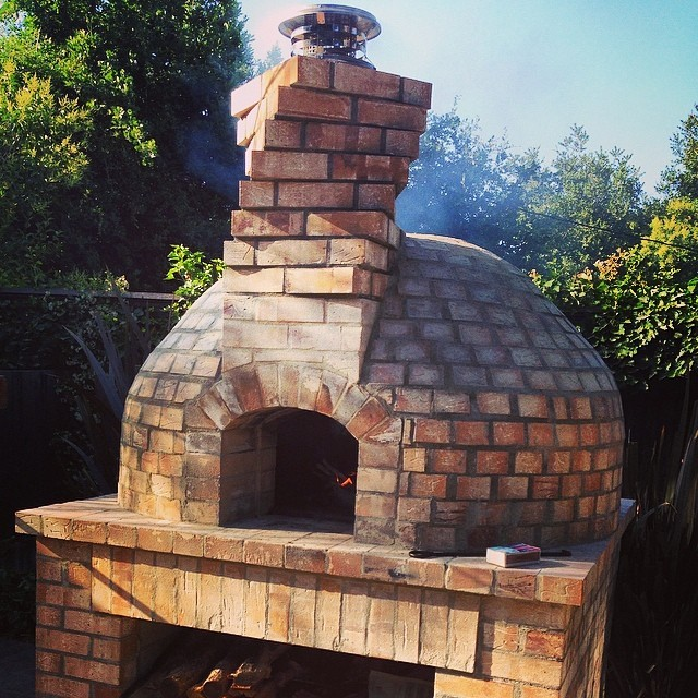 Slowly curing the oven.  It all started with a couple loads of ancient firebrick from the demolished ovens of Oakland's once famed Columbo Bakery.  Community baking days announced soon:  pots of beans, haunches of ham, and long-risen loaves welcome. (at at home in Napa)