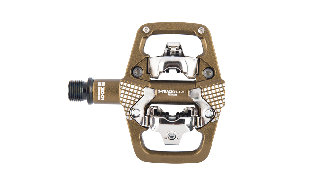 X-Track En-Rage Plus Bronze - The X-TRACK EN-RAGE, designed for the TRAIL / ENDURO discipline completes our off-road range of pedals by offering a wider pedal body. With more contact area it offers added stability, and construction to withstand the hardest of knocks