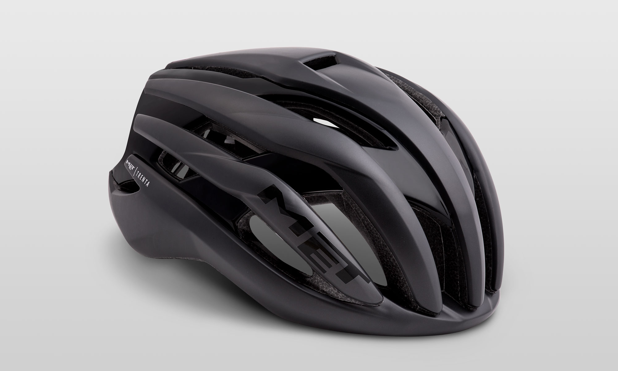 Trenta - Enhanced for use in the peloton, the MET Trenta's tube-shaped tail and internal channeling ensure it performs best when riding in a group, offering up to 7% reduction in drag vs a traditional road helmet.