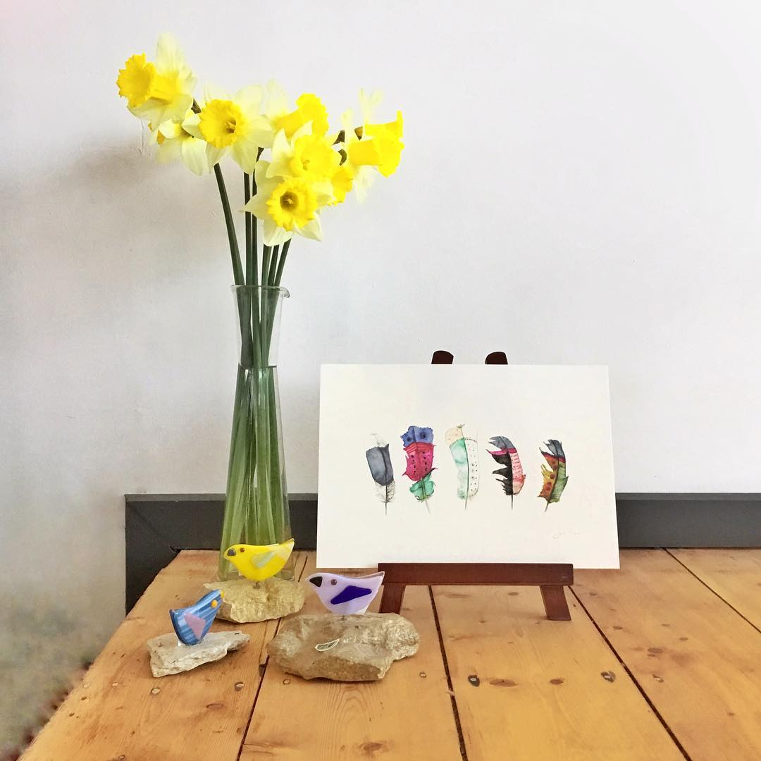 Watercolour feather print with vase of daffodils