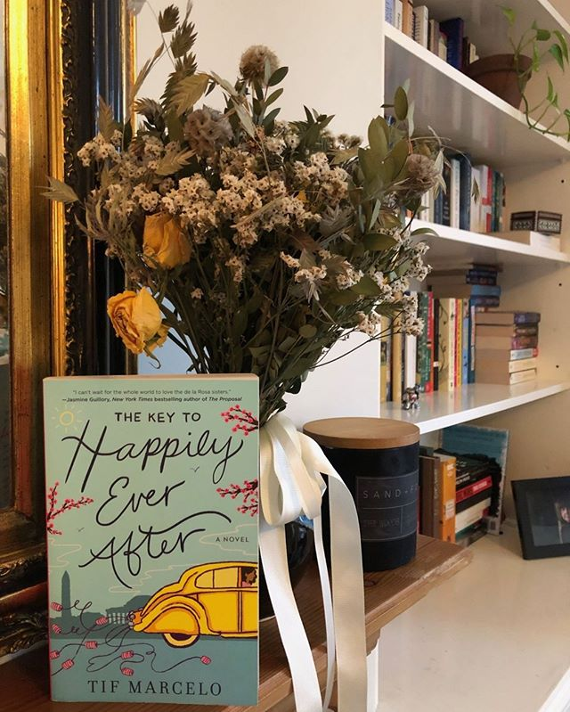 Julia loved The Key to Happily Ever After by @tifmarcelo, a wonderful women's fiction that puts sisters right at the center of it. The sisters are all in the wedding planning business, so it seemed only fitting to snap a photo of it with Julia's bridesmaid flowers from Justine's wedding! 😍 💐 #TheKeytoHappilyEverAfter #podcast #bookstagram #booksofinstagram #booknerd #books #novel #womensfiction #weddingplanner #sisters