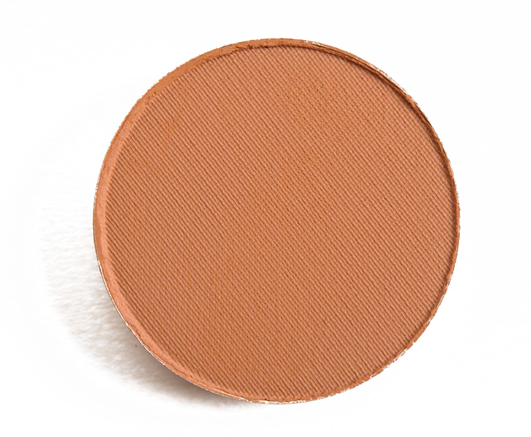 MAC eyeshadow in the color SADDLE - 3. This eyeshadow is a warm matte brown that is blendable, buildable, and buttery. BONUS: Can be used as a brow powder too! ($17 USD here).