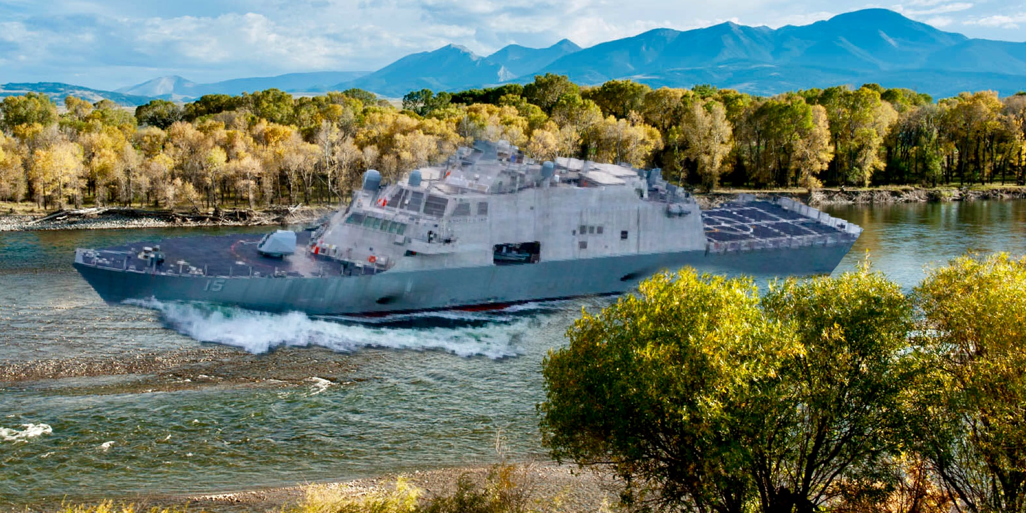 The uss billings making its maiden voyage up the yellowstone river